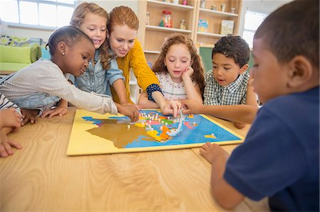 Children and teacher playing in class Stock Photo - Premium Royalty-Free, Code: 6113-07731161
