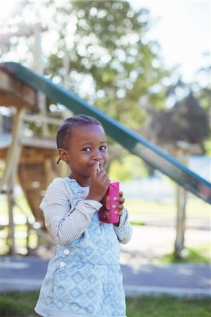 entry field - Girl drinking juice box at playground Stock Photo - Premium Royalty-Free, Code: 6113-07731188