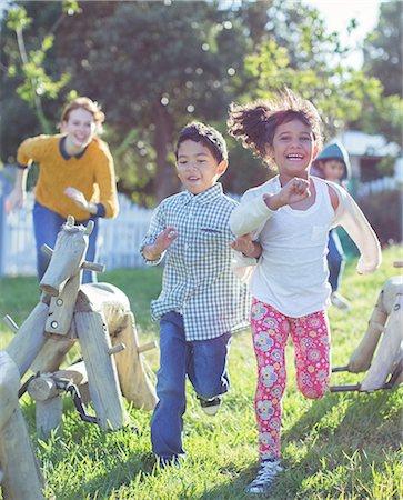filipino - Children running on playground Stock Photo - Premium Royalty-Free, Code: 6113-07731196