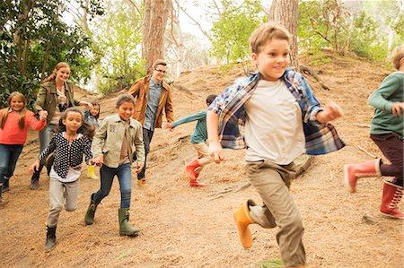 Children running in forest Stock Photo - Premium Royalty-Free, Code: 6113-07731136