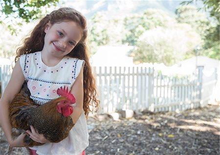 farming (raising livestock) - Girl holding chicken at petting zoo Stock Photo - Premium Royalty-Free, Code: 6113-07731268