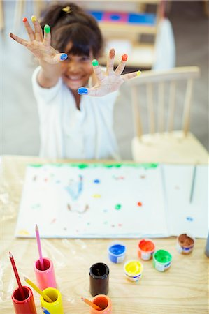 Student finger painting in classroom Stock Photo - Premium Royalty-Free, Code: 6113-07731276