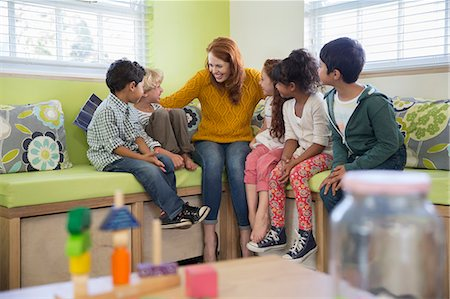 filipino - Students and teacher talking in classroom Stock Photo - Premium Royalty-Free, Code: 6113-07731286