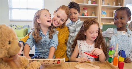 fun - Students and teacher playing in classroom Stock Photo - Premium Royalty-Free, Code: 6113-07731288