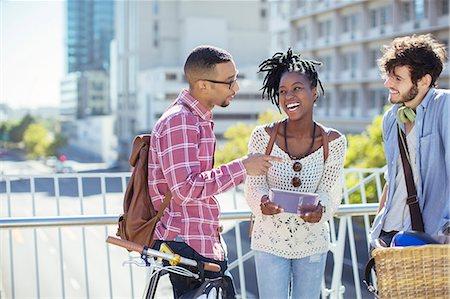 friendship - Friends talking on city street Stock Photo - Premium Royalty-Free, Code: 6113-07731360