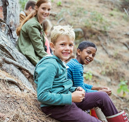Students and teachers smiling in forest Stock Photo - Premium Royalty-Free, Code: 6113-07731315