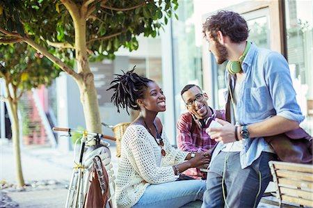 friendship - Friends talking on city street Stock Photo - Premium Royalty-Free, Code: 6113-07731407
