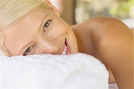 Close up of woman smiling on massage table Stock Photo - Premium Royalty-Free, Code: 6113-07731544