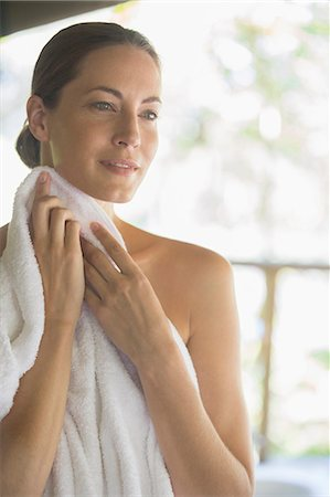 Woman toweling herself off Stock Photo - Premium Royalty-Free, Code: 6113-07731545