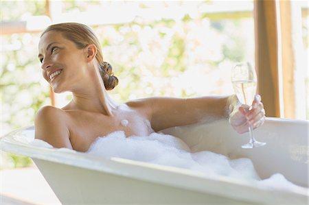 Woman having champagne in bubble bath Stock Photo - Premium Royalty-Free, Code: 6113-07731573