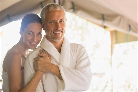 Smiling couple hugging Stock Photo - Premium Royalty-Free, Code: 6113-07731578