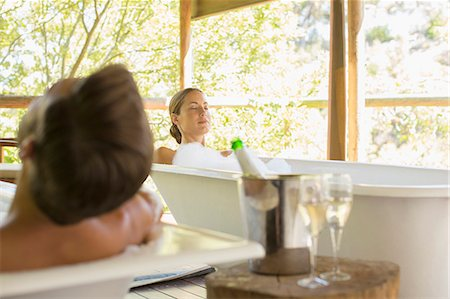 Couple relaxing together in spas Stock Photo - Premium Royalty-Free, Code: 6113-07731590