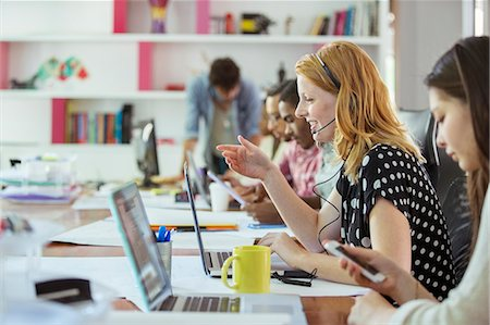 People working at conference table in office Stock Photo - Premium Royalty-Free, Code: 6113-07731503