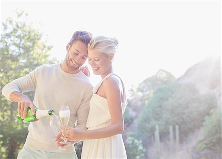 Couple drinking champagne outdoors Stock Photo - Premium Royalty-Free, Code: 6113-07731641