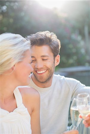 Couple toasting each other with champagne together outdoors Stock Photo - Premium Royalty-Free, Code: 6113-07731647