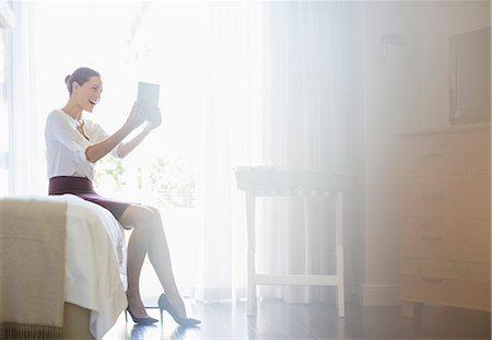 Businesswoman using digital tablet in hotel room Stock Photo - Premium Royalty-Free, Code: 6113-07731657
