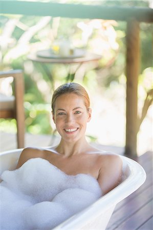 Woman relaxing in bubble bath Stock Photo - Premium Royalty-Free, Code: 6113-07731601