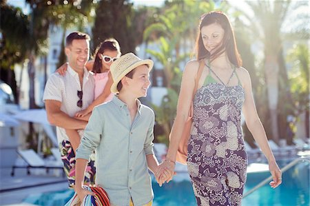 pool - Family with two children walking by swimming pool Stock Photo - Premium Royalty-Free, Code: 6113-07808092
