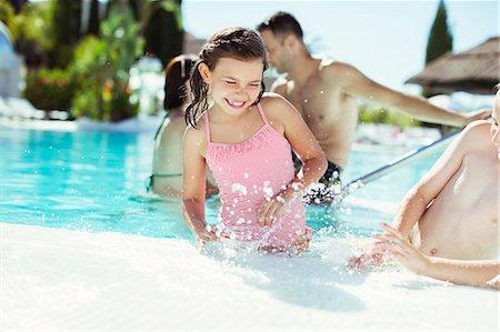 preteen girl topless - Happy children splashing water in swimming pool Stock Photo - Premium Royalty-Free, Code: 6113-07808095