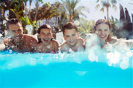 preteen family - Portrait of family with two children in swimming pool Stock Photo - Premium Royalty-Free, Code: 6113-07808096