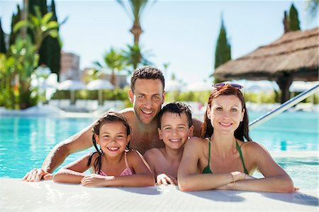 preteen girl topless - Portrait of family with two children in swimming pool Stock Photo - Premium Royalty-Free, Code: 6113-07808142