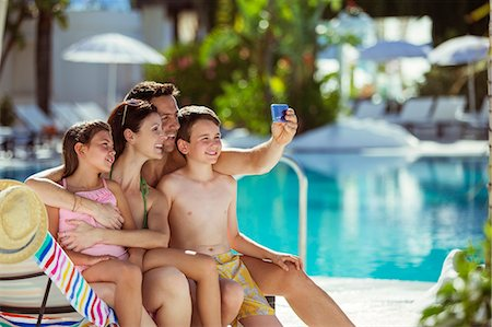 Family with two children taking selfie by swimming pool Stock Photo - Premium Royalty-Free, Code: 6113-07808149