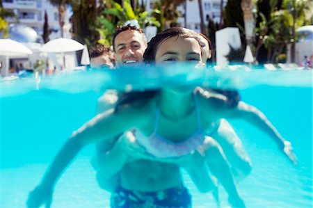 Portrait of girl and her father in swimming pool Stock Photo - Premium Royalty-Free, Code: 6113-07808154