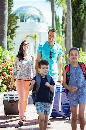 Family with luggage walking towards tourist resort Stock Photo - Premium Royalty-Free, Code: 6113-07808158