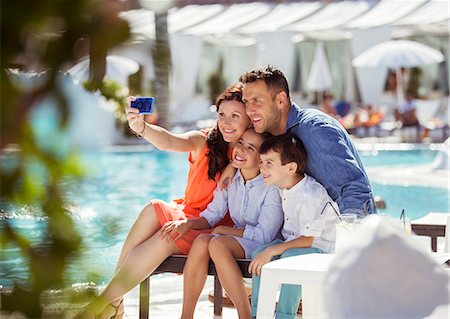preteen family - Family with two children taking selfie by resort swimming pool Stock Photo - Premium Royalty-Free, Code: 6113-07808166