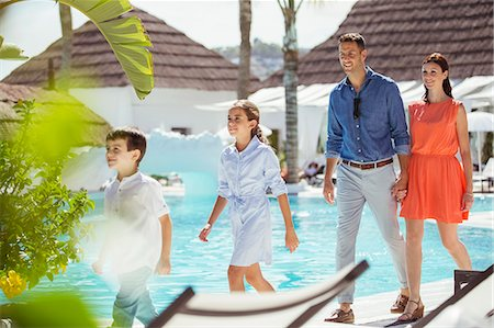 pool - Family with two children walking together by swimming pool Stock Photo - Premium Royalty-Free, Code: 6113-07808168