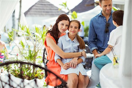 Happy family with two children relaxing in resort pool area Stock Photo - Premium Royalty-Free, Code: 6113-07808101