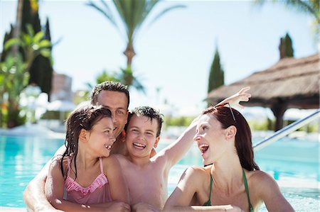 Family with two children enjoying themselves in swimming pool Stock Photo - Premium Royalty-Free, Code: 6113-07808104