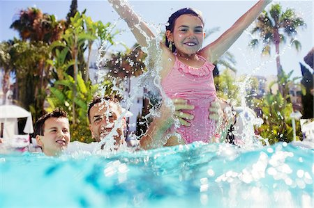 family  fun  outside - Father playing with son and daughter in swimming pool Stock Photo - Premium Royalty-Free, Code: 6113-07808109