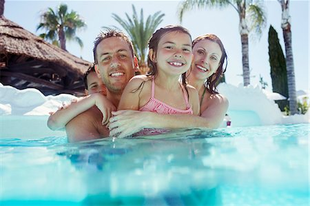 Portrait of happy family with son and daughter in swimming pool Stock Photo - Premium Royalty-Free, Code: 6113-07808117