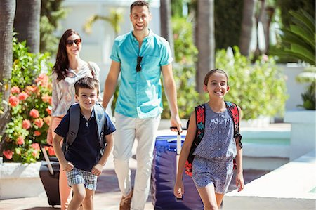 Family with suitcases walking towards tourist resort Stock Photo - Premium Royalty-Free, Code: 6113-07808118