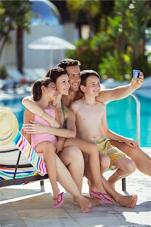 Family with two children taking selfie by swimming pool Stock Photo - Premium Royalty-Free, Code: 6113-07808123