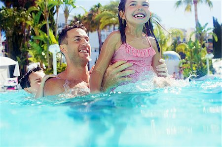 preteen bathing suit - Father with daughter and son playing in swimming pool Stock Photo - Premium Royalty-Free, Code: 6113-07808139