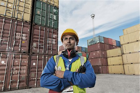 portrait looking away - Worker standing near cargo containers Stock Photo - Premium Royalty-Free, Code: 6113-07808370