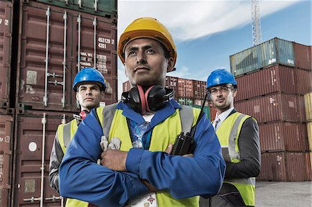 standing - Worker and businessmen standing near cargo containers Stock Photo - Premium Royalty-Free, Code: 6113-07808386