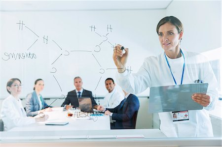 drawing - Scientist drawing chemical formula on glass for business people and colleagues Stock Photo - Premium Royalty-Free, Code: 6113-07808448