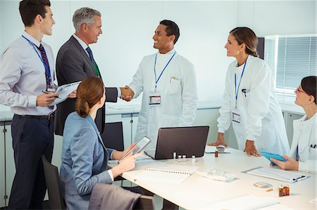 Scientists and business people talking in conference room Stock Photo - Premium Royalty-Free, Code: 6113-07808478