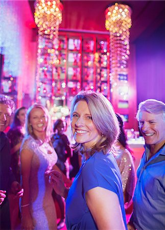 Happy mature people having fun in nightclub Stock Photo - Premium Royalty-Free, Code: 6113-07808592