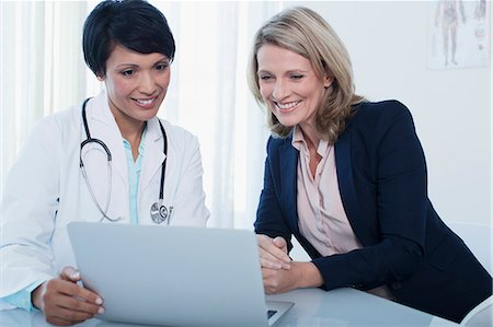female doctor - Doctor and patient using laptop in hospital office Stock Photo - Premium Royalty-Free, Code: 6113-07808658