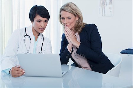 female doctor - Female doctor and patient using laptop in hospital office Stock Photo - Premium Royalty-Free, Code: 6113-07808688