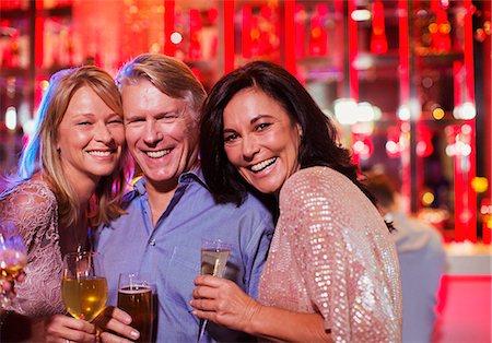 Portrait of smiling mature man and women in nightclub Stock Photo - Premium Royalty-Free, Code: 6113-07808622