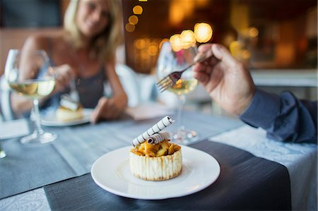 Couple eating dessert in fancy restaurant Stock Photo - Premium Royalty-Free, Code: 6113-07808637