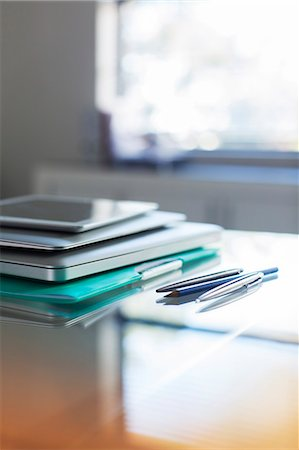 selective focus computer no people - Documents and digital tablet on desk in office Stock Photo - Premium Royalty-Free, Code: 6113-07808861