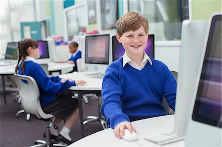 school girl uniforms - Primary school children working with computers Stock Photo - Premium Royalty-Free, Code: 6113-07961484