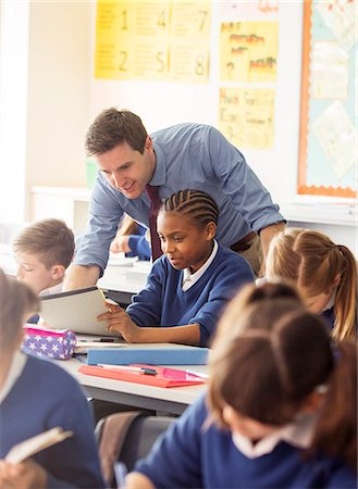 school desk - Teacher with his pupils in classroom Stock Photo - Premium Royalty-Free, Code: 6113-07961404