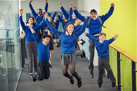 school - Enthusiastic high school students wearing school uniforms smiling and jumping in school corridor Stock Photo - Premium Royalty-Free, Code: 6113-07961429